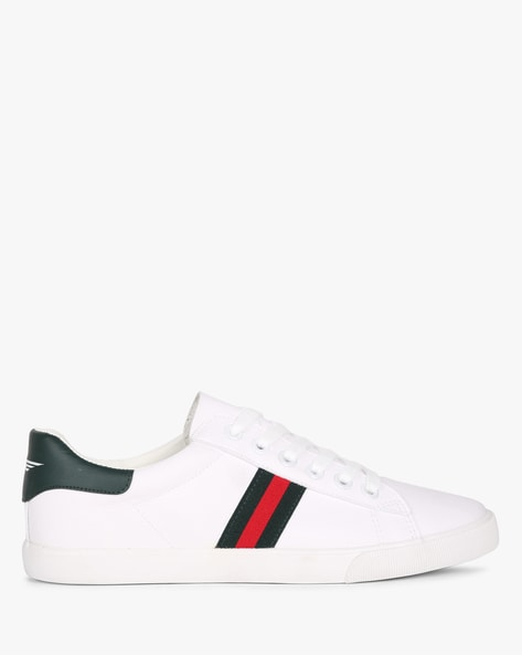 red tape white shoes