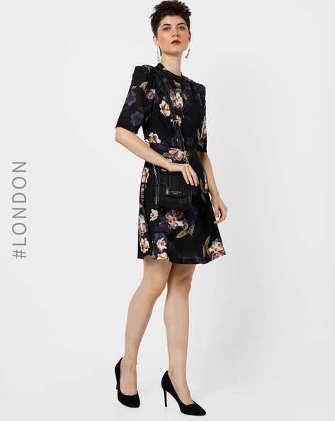 Floral Print Skater Dress With Panelled Sleeves By Angel Eye ( Black )