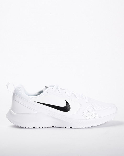 Buy White Sports Shoes for Men by NIKE